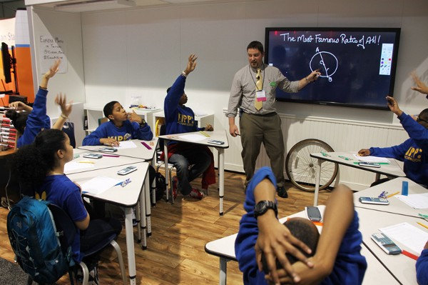 """A teacher at a digital whiteboard asks students about """"The Most Famous Ratio of All!"""""""