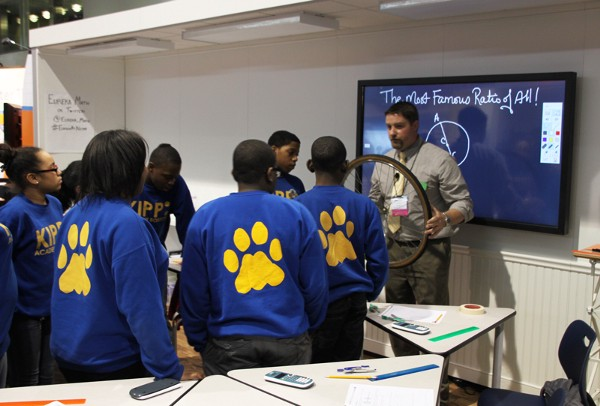 A teacher invites students to examine a bike tire while discussing Pi.