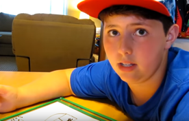 Tucker looks at the camera while explaining his worksheet.